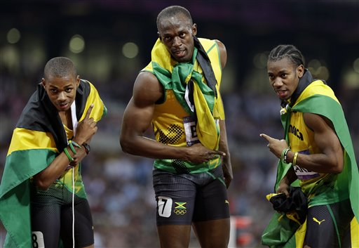 Jamaica&#39;s Usain Bolt, center, poses with compatriots Warren Weir, left, and Yohan Blake, right, after their medal sweep in the men&#39;s 200-meter final during the athletics in the Olympic Stadium at the 2012 Summer Olympics, London, Thursday, Aug. 9, 2012. Bolt took first place, Blake took second and Weir took third place. <span class=meta>(AP Photo&#47;Anja Niedringhaus)</span>