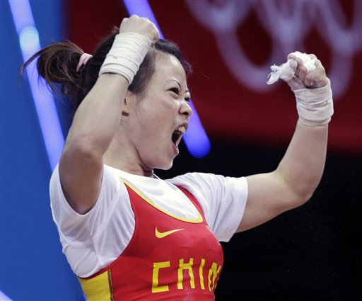 "<div class=""meta image-caption""><div class=""origin-logo origin-image ""><span></span></div><span class=""caption-text"">China's Wang Mingjuan reacts during the women's 48-kg weightlifting event where she won the gold medal at the 2012 Summer Olympics, Saturday, July 28, 2012, in London.  (AP Photo/Mike Groll)</span></div>"
