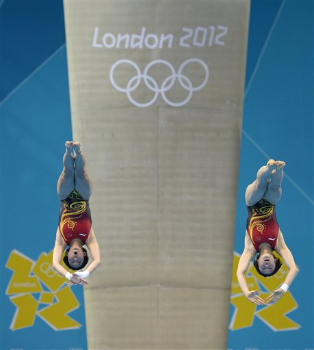 Chen Ruolin and Wang Hao of China compete during the women&#39;s synchronized 10-meter platform diving final at the Aquatics Centre in the Olympic Park during the 2012 Summer Olympics in London, Tuesday, July 31, 2012. China won the gold medal in the event. <span class=meta>(AP Photo&#47;Mark J. Terrill)</span>