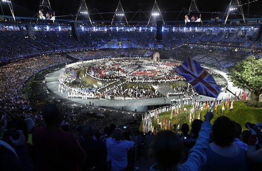 A spectator waves a flag of Great Britain as athletes gather at the Olympic Stadium during the Opening Ceremony at the 2012 Summer Olympics, Friday, July 27, 2012, in London. <span class=meta>(AP Photo&#47;Markus Schreiber)</span>