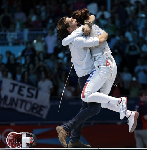 Italy&#39;s Elisa Di Francisca reacts after defeating Italy&#39;s Arianna Errigo in the gold medal fencing match at the 2012 Summer Olympics, Saturday, July 28, 2012, in London.  <span class=meta>(AP Photo&#47;Dmitry Lovetsky)</span>