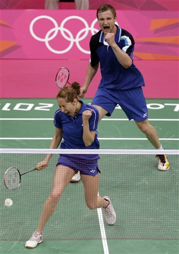 Russia&#39;s Valeria Sorokina, left, and teammate Alexandr Nikolaenko celebrate after beating Britain&#39;s Chris Adcock and Imogen Bankier in a mixed doubles badminton match at the 2012 Summer Olympics, Saturday, July 28, 2012, in London.  <span class=meta>(AP Photo&#47;Andres Leighton)</span>
