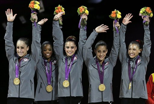 U.S. gymnasts, left to right, Jordyn Wieber, Gabrielle Douglas, McKayla Maroney, Alexandra Raisman, Kyla Ross raise their hands on the podium during the medal ceremony during the Artistic Gymnastic women&#39;s team final at the 2012 Summer Olympics, Tuesday, July 31, 2012, in London. Team U.S. won the gold.  <span class=meta>(AP Photo&#47;Gregory Bull)</span>