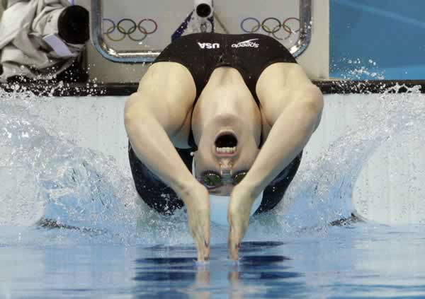 "<div class=""meta ""><span class=""caption-text "">United States' Missy Franklin starts in a women's 100-meter backstroke swimming heat at the Aquatics Centre in the Olympic Park during the 2012 Summer Olympics in London, Sunday, July 29, 2012. (AP Photo/Michael Sohn) </span></div>"