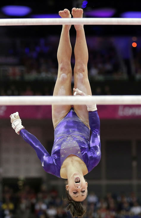 U.S. gymnast Jordyn Wieber performs on the uneven barsduring the Artistic Gymnastics women's qualification at the 2012 Summer Olympics, Sunday, July 29, 2012, in London. (AP Photo/Gregory Bull)