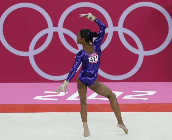 U.S. gymnast Gabrielle Douglas performs on the floor during the Artistic Gymnastic women's qualifications at the 2012 Summer Olympics, Sunday, July 29, 2012, in London. (AP Photo/Julie Jacobson)