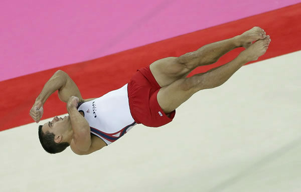 U.S. gymnast Jacob Dalton performs on the floor during the Artistic Gymnastic men's team final at the 2012 Summer Olympics, Monday, July 30, 2012, in London. (AP Photo/Gregory Bull)