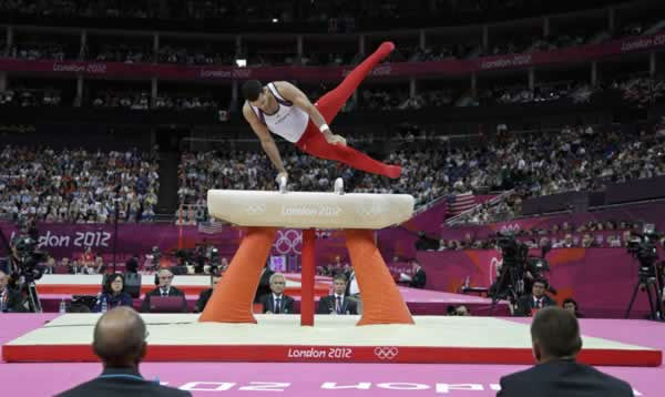 U.S. gymnast Danell Leyva performs on the pommel horse during the Artistic Gymnastic men's team final at the 2012 Summer Olympics, Monday, July 30, 2012, in London. (AP Photo/Julie Jacobson)