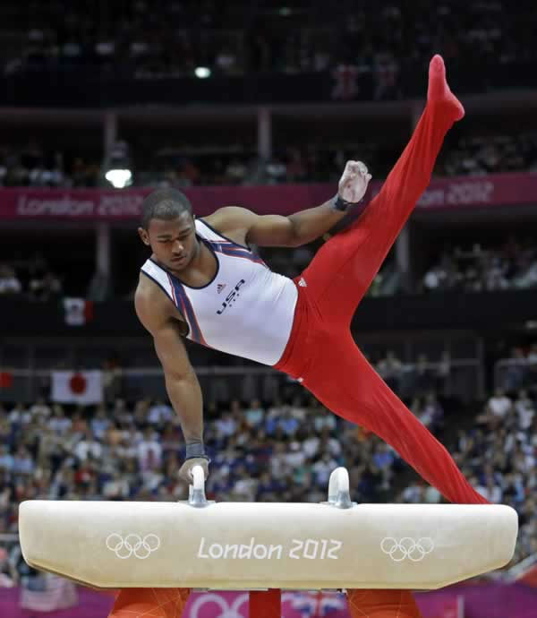 U.S. gymnast John Orozco performs on the pommel horse during the Artistic Gymnastic men's team final at the 2012 Summer Olympics, Monday, July 30, 2012, in London. (AP Photo/Julie Jacobson)