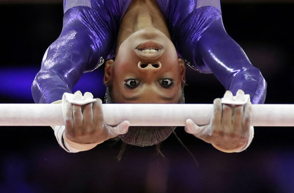 "<div class=""meta ""><span class=""caption-text "">U.S. gymnast Gabrielle Douglas performs on the uneven bars during the Artistic Gymnastics women's qualification at the 2012 Summer Olympics, Sunday, July 29, 2012, in London. (AP Photo/Gregory Bull)   </span></div>"