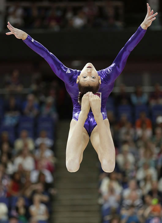 "<div class=""meta ""><span class=""caption-text "">U.S. gymnast Kyla Ross performs on the balance beam during the Artistic Gymnastics women's qualification at the 2012 Summer Olympics, Sunday, July 29, 2012, in London. (AP Photo/Gregory Bull) </span></div>"