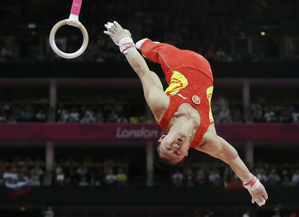 "<div class=""meta ""><span class=""caption-text "">Chinese gymnast Chen Yibing performs on the rings during the Artistic Gymnastic men's team final at the 2012 Summer Olympics, Monday, July 30, 2012, in London. (AP Photo/Julie Jacobson) </span></div>"
