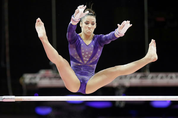 U.S. gymnast Alexandra Raisman performs on the uneven bars during the Artistic Gymnastics women's qualification at the 2012 Summer Olympics, Sunday, July 29, 2012, in London. (AP Photo/Gregory Bull)