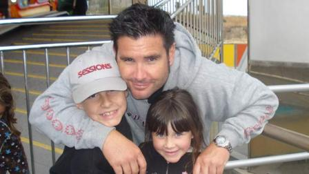File -- This undated image provided Tuesday April 5, 2011 by John Stow shows Bryan Stow holding his 12-year-old son and 8-year-old daughter.