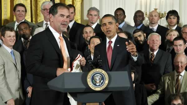 President Barack Obama, is presented with a San Francisco Giants jersey by Giants manager Bruce Bochy