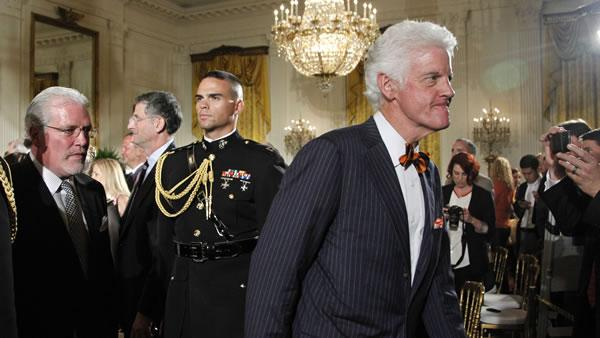San Francisco Giants owner Bill Neukom, right, is followed by General Manager Brian Sabean