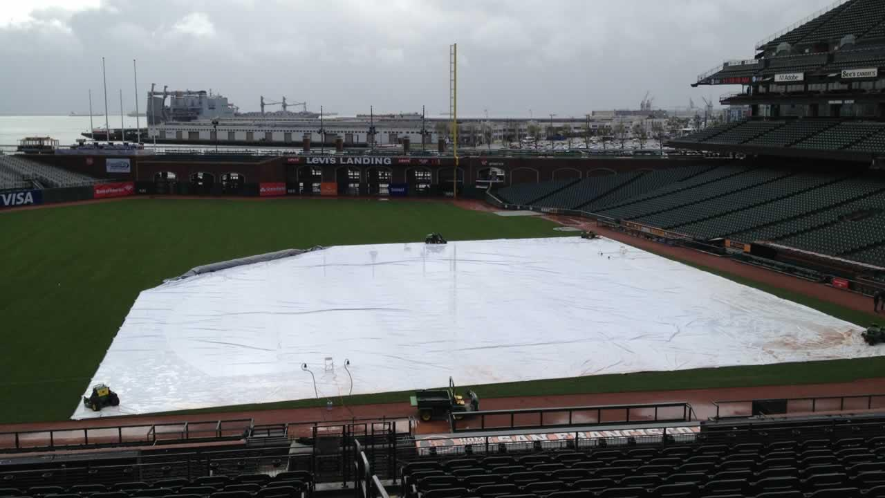 The tarp covers the baseball diamond at AT&T Park in San Francisco.
