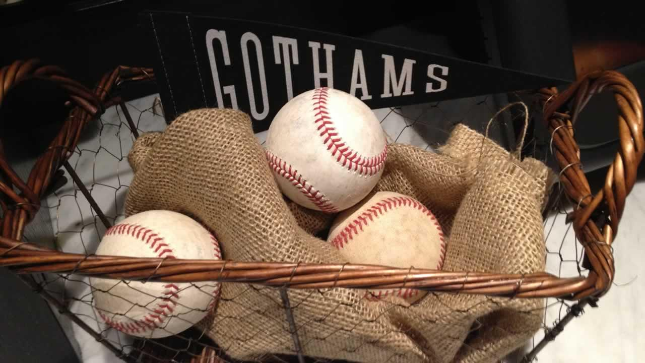Basket of baseballs.