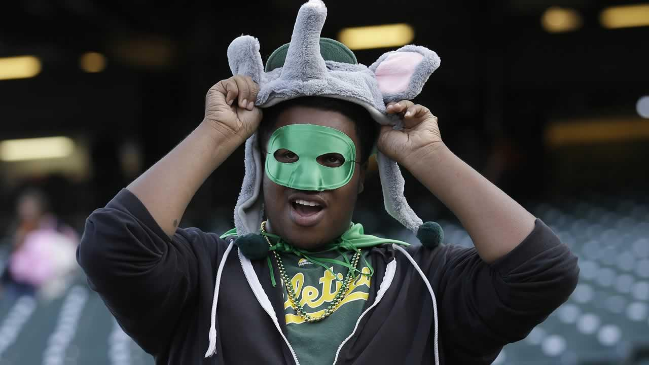 Oakland Athletics fan Andre Monk watches as the Athletics warm up before an exhibition baseball game.