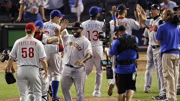 "<div class=""meta ""><span class=""caption-text "">National League's Pablo Sandoval, of the San Francisco Giants, right, celebrates with teammates after their 8-0 win over the American League in the MLB All-Star baseball game, Tuesday, July 10, 2012, in Kansas City, Mo. (AP Photo/Charlie Neibergall)</span></div>"