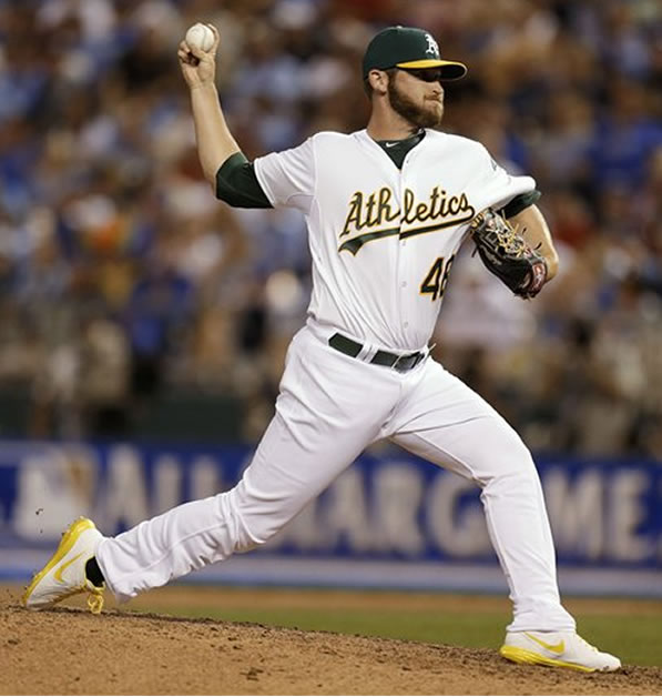 American League's Ryan Cook, of the Oakland Athletics, pitches during the seventh inning of the MLB All-Star baseball game, Tuesday, July 10, 2012, in Kansas City, Mo. (AP Photo/Jeff Roberson)