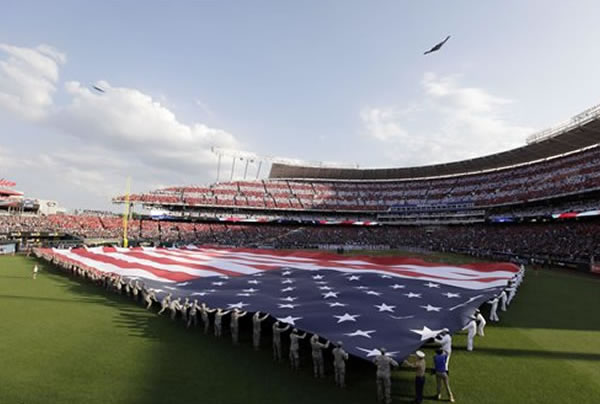 A military aircraft flies over Kauffman Stadium during the national anthem before the MLB All-Star baseball game, Tuesday, July 10, 2012, in Kansas City, Mo. (AP Photo/Charlie Neibergall)