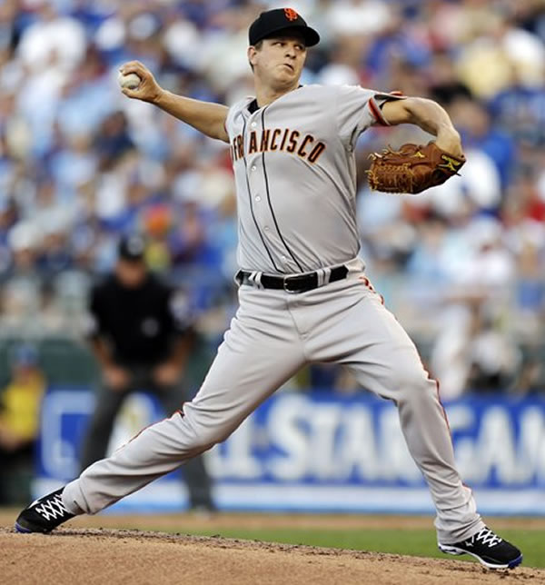 National League's Matt Cain, of the San Francisco Giants, delivers against the American League during first inning of the MLB All-Star baseball game, Tuesday, July 10, 2012, in Kansas City, Mo. (AP Photo/Jeff Roberson)