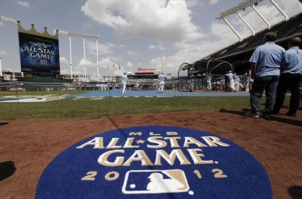 American League players warm up before the MLB All-Star baseball game, Tuesday, July 10, 2012, in Kansas City, Mo. (AP Photo/Charlie Riedel)