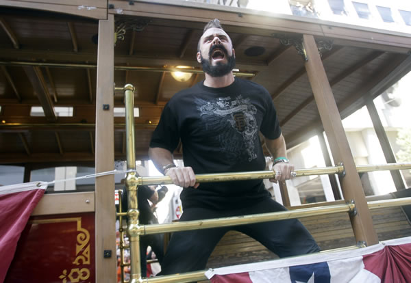 "<div class=""meta ""><span class=""caption-text "">San Francisco Giants relief pitcher Brian Wilson celebrates while riding in a motorized cable car during a baseball World Series parade in downtown San Francisco, Wednesday, Nov. 3, 2010. The Giants defeated the Texas Rangers in five games for their first championship since the team moved west from New York 52 years ago. (AP Photo/Jeff Chiu)  </span></div>"