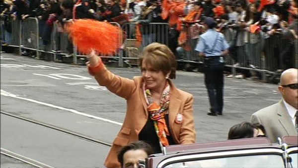 Nancy Pelosi waves to the crowd at the SF Giants World Series parade