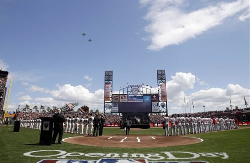 Planes fly over as the national anthem is played at the start of the San Francisco Giants home-opening baseball game against the St. Louis Cardinals in San Francisco, Friday, April 8, 2011. (AP Photo/Pool, Marcio Jose Sanchez)