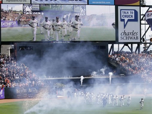 The San Francisco Giants run unto the field as they are introduced for their home-opening baseball game against the St. Louis Cardinals in San Francisco, Friday, April 8, 2011. (AP Photo/Eric Risberg)