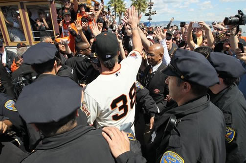 San Francisco Giants relief pitcher Brian Wilson high-fives fans after lifting the team's World Series championship flag before their home-opening baseball game against the St. Louis Cardinals in San Francisco, Friday, April 8, 2011. (AP Photo/Getty Images, Justin Sullivan, Pool)