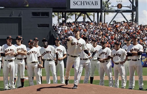 "<div class=""meta image-caption""><div class=""origin-logo origin-image ""><span></span></div><span class=""caption-text"">San Francisco Giants starting pitcher Matt Cain throws the game's ceremonial first pitch as his teammates look on before the start of their home-opener against the St. Louis Cardinals in a baseball game in San Francisco, Friday, April 8, 2011. (AP Photo/Marcio Jose Sanchez)</span></div>"