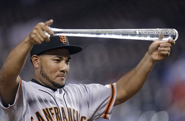 National League's Melky Cabrera, of the San Francisco Giants, shows off his MVP trophy after the MLB All-Star baseball game Tuesday, July 10, 2012, in Kansas City, Mo. The National League won 8-0. (AP Photo/Jeff Roberson)