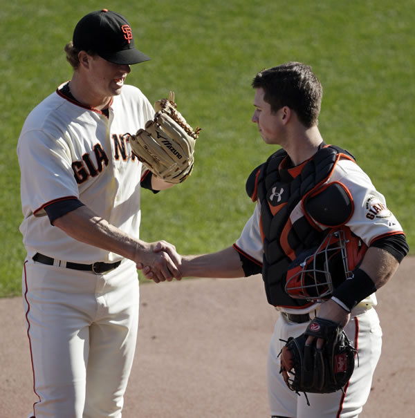 San Francisco Giants starting pitcher Matt Cain shake hands with catcher Buster Posey after the seventh inning of Game 3 of baseball's National League Championship Series against the Philadelphia Phillies Tuesday, Oct. 19, 2010, in San Francisco. (AP Photo/Ben Margot)