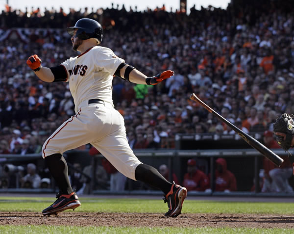 San Francisco Giants' Cody Ross hits a run-scoring single during the fourth inning of Game 3 of baseball's National League Championship Series against the Philadelphia Phillies Tuesday, Oct. 19, 2010, in San Francisco. (AP Photo/Jeff Chiu)