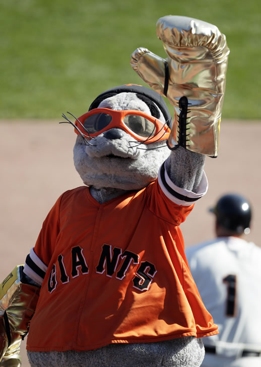 San Francisco Giants mascot Lou Seal entertains the crown during Game 3 of baseball's National League Championship Series Tuesday, Oct. 19, 2010, in San Francisco. (AP Photo/Ben Margot)