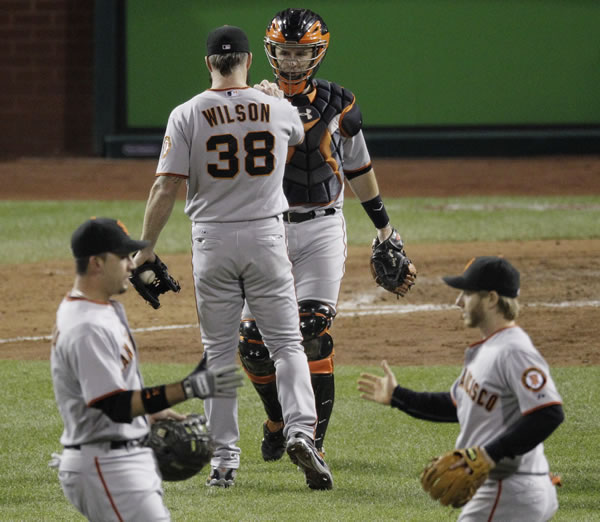 "<div class=""meta image-caption""><div class=""origin-logo origin-image ""><span></span></div><span class=""caption-text"">San Francisco Giants relief pitcher Brian Wilson shakes hands with catcher Buster Posey after Game 1 of baseball's National League Championship Series against the Philadelphia Phillies Saturday, Oct. 16, 2010, in Philadelphia. The Giants won 4-3 to take a 1-0 lead in the series. (AP Photo/Eric Gay)  </span></div>"