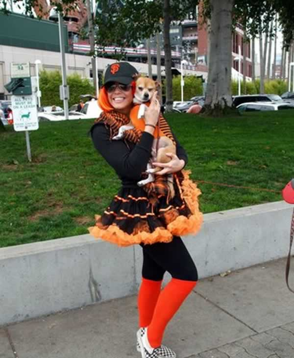 This is a fan at the Marina by the ballpark holding my pooch, Chiquito. Go Giants!!!  (Photo submitted by Kaye Kennedy of San Francisco  via uReport)
