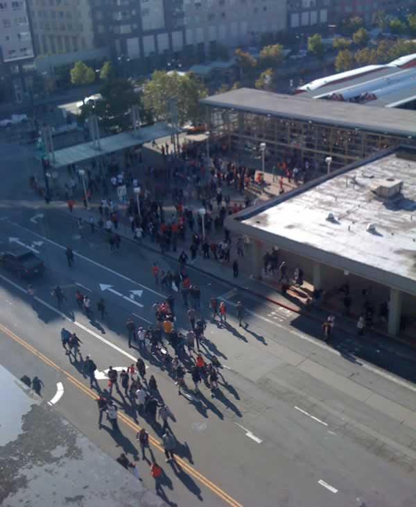 "<div class=""meta ""><span class=""caption-text "">Crowd coming in from Caltrain at 11:50 a.m., steady stream coming in since 8 a.m.  (Photo submitted by Brandon R. Guzman via uReport) (KGO)</span></div>"
