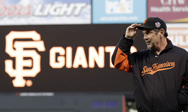 San Francisco Giants manager Bruce Bochy tips his hat during practice for Game 1 of baseball's World Series against the Texas Rangers Tuesday, Oct. 26, 2010, in San Francisco. (AP Photo/David J. Phillip)