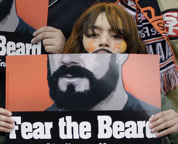 A fan holds up a sign before Game 1 of baseball's World Series between the San Francisco Giants and the Texas Rangers Wednesday, Oct. 27, 2010, in San Francisco. (AP Photo/Marcio Jose Sanchez)