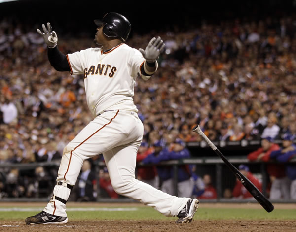 San Francisco Giants' Juan Uribe hits a three-run home run during the fifth inning of Game 1 of baseball's World Series against the Texas Rangers Wednesday, Oct. 27, 2010, in San Francisco. (AP Photo/Marcio Jose Sanchez)