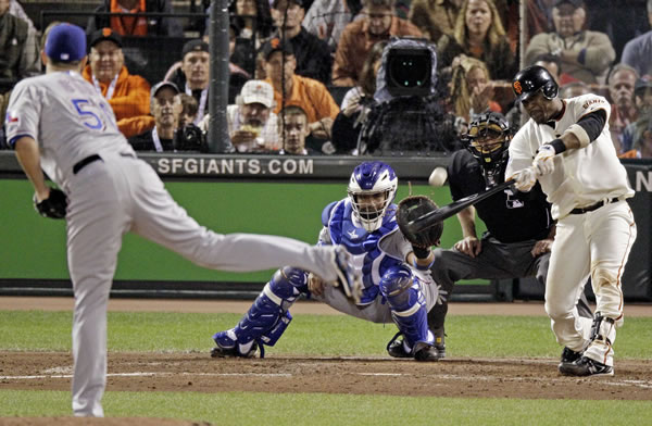 San Francisco Giants' Juan Uribe hits a three-run home run during the fifth inning of Game 1 of baseball's World Series against the Texas Rangers Wednesday, Oct. 27, 2010, in San Francisco. (AP Photo/Eric Gay)