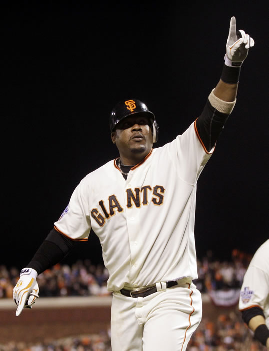 San Francisco Giants' Juan Uribe reacts after hitting a three-run home run during the fifth inning of Game 1 of baseball's World Series against the Texas Rangers Wednesday, Oct. 27, 2010, in San Francisco. (AP Photo/Marcio Jose Sanchez)