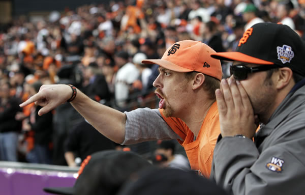Fans react during the second inning of Game 2 of baseball's World Series between the San Francisco Giants and the Texas Rangers Thursday, Oct. 28, 2010, in San Francisco. (AP Photo/Eric Gay)