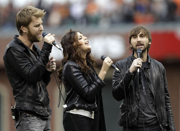 Country group Lady Antebellum sings the national anthem before Game 2 of baseball's World Series between the San Francisco Giants and the Texas Rangers Thursday, Oct. 28, 2010, in San Francisco. (AP Photo/Marcio Jose Sanchez)