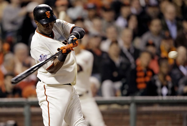 San Francisco Giants' Edgar Renteria hits a home run during the fifth inning of Game 2 of baseball's World Series against the Texas Rangers Thursday, Oct. 28, 2010, in San Francisco. (AP Photo/David J. Phillip)
