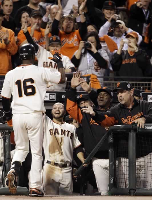 San Francisco Giants' Edgar Renteria (16) is congratulated after hitting a home run during the fifth inning of Game 2 of baseball's World Series against the Texas Rangers Thursday, Oct. 28, 2010, in San Francisco. (AP Photo/David J. Phillip)